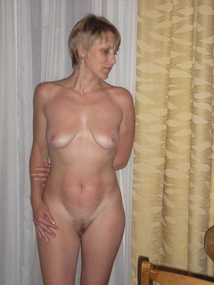 Nude sexy housewife wearing only a..