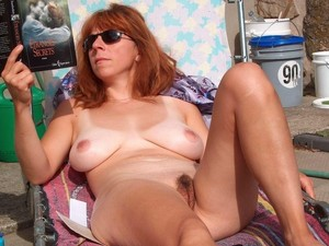 Naked Mature women with glasses near..