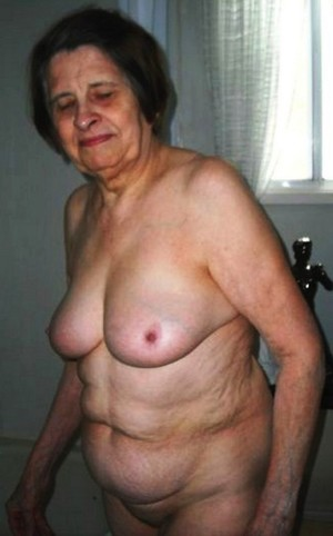 Old woman with wrinkled skin and huge..