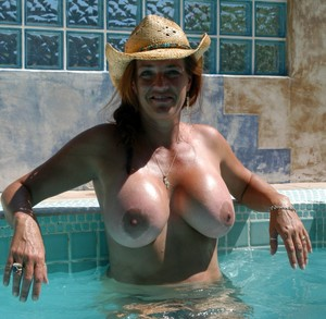 Tanned old lady with big boobs and a..