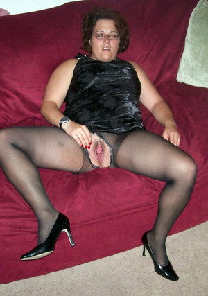 Plump MILF in black torn stockings and..