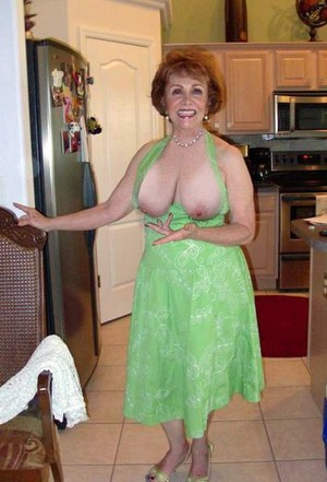 This mature slut masturbates..