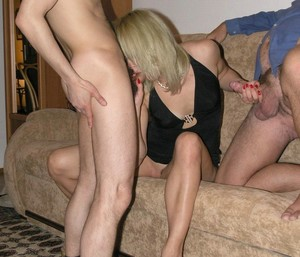 Swinger housewife having group sex at..