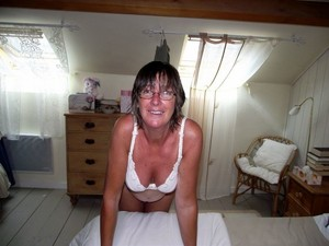 This busty mature wife always topless..