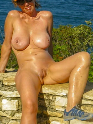 Some blonde wife posing near waterfall